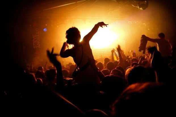 Partying in the club is banned in Saskatchewan, but by mid-July it could become a possibility. The province plans to end most of its restrictions by summer.  (Anthony Mooney/Shutterstock - image credit)