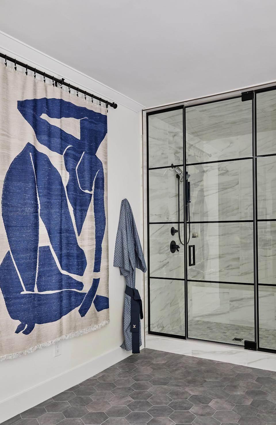 "A wall hanging of Henri Matisse's Blue Nude III brings an elegant serenity to Miley's primary bathroom. Miley's home also features a large and decidedly calm, neutral-toned wellness and gym studio. ""I was inspired by Amangiri,"" Miley says. ""It was a really spiritual experience. I was there when I was going through a very public breakup, and I went and found a kind of a sanctuary there with my older sister and my mom."""
