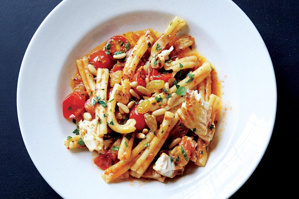 """Bursting with sweet cherry tomatoes and golden raisins, this simple seafood pasta comes together in just 30 minutes. <a href=""""https://www.epicurious.com/recipes/food/views/pasta-with-swordfish-and-cherry-tomato-sauce-56389845?mbid=synd_yahoo_rss"""" rel=""""nofollow noopener"""" target=""""_blank"""" data-ylk=""""slk:See recipe."""" class=""""link rapid-noclick-resp"""">See recipe.</a>"""