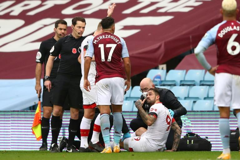 Southampton striker Danny Ings gestures as he gets attention for the knee injury
