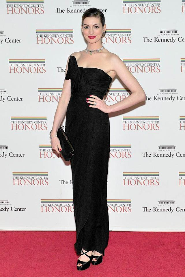 "Also in attendance at the A-list soiree was Anne Hathaway, who struck a regal pose in a strapless Giambattista Valli column gown. The ""Devil Wears Prada"" star -- who sported a sleek bun for the occasion -- completed her classy look with a diamond choker. (12/03/2011)"