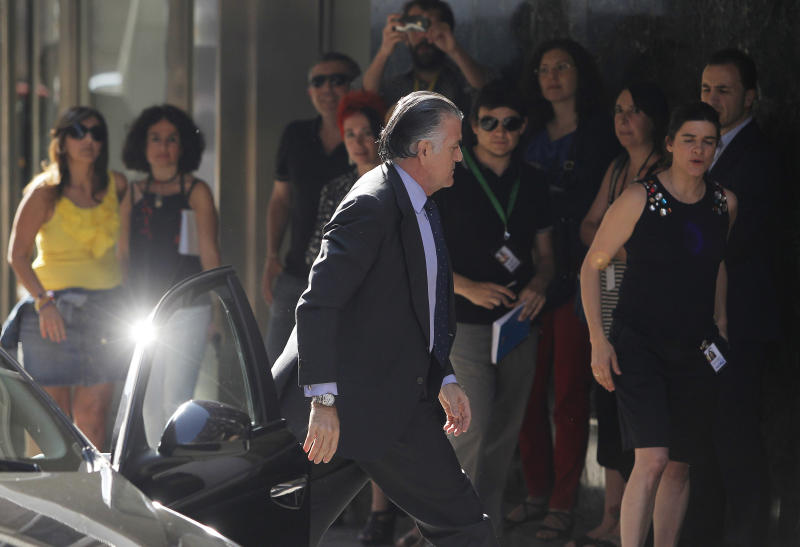 Former Popular Party treasurer, Luis Barcenas arrives the National Court in Madrid, Spain, Thursday, June 27, 2013. A judge has held that Barcenas represented a flight risk and should be held in jail while he awaits trial on charges of tax fraud and money laundering. Barcenas was treasurer of Prime Minister Mariano Rajoy's ruling Popular Party from 2008 to 2009 and a senator from 2004 to 2010. He is accused of keeping up to 47 million euros in secret Swiss bank accounts. (AP Photo/Andres Kudacki)