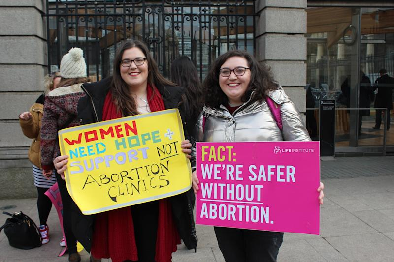 Roisin Ni Fhloinn, left, demonstrates against abortion outside Ireland's lower house of Parliament with her sister. (Jesselyn Cook/HuffPost)