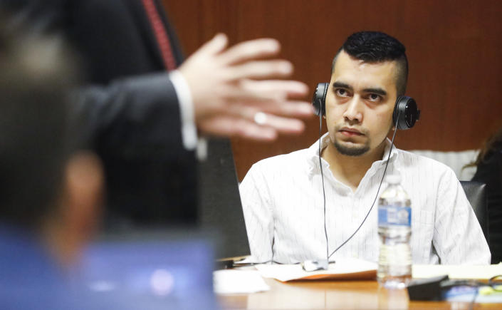 Cristhian Bahena Rivera listens to Poweshiek County Attorney Bart Klaver give his opening statement at his trial at the Scott County Courthouse in Davenport, Iowa, on Wednesday, May 19, 2021. Rivera is charged with first-degree in the death of Mollie Tibbetts. (Jim Slosiarek/The Gazette via AP, Pool)