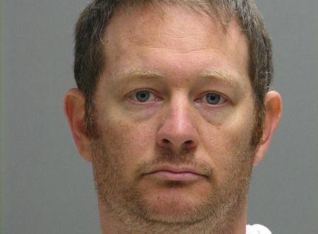 FILE PHOTO: Lee Robert Moore is pictured in this undated booking photo provided by the Delaware Department of Justice