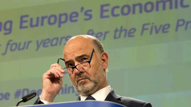 European Commissioner for Economic and Financial Affairs Pierre Moscovici pauses before speaking during a media conference at EU headquarters in Brussels, Wednesday, June 12, 2019. The European Commission on Wednesday took stock of the progress made to deepen Europe's Economic and Monetary Union and calls on Member States to take further concrete steps. (AP Photo/Virginia Mayo)