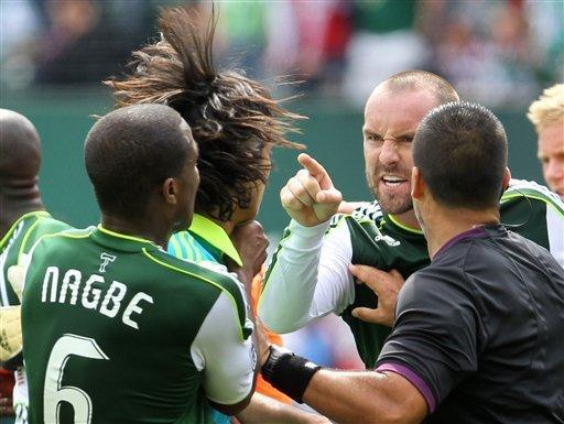 Portland Timbers' Kris Boyd, right, goes after Seattle Sounders' Fredy Montero, second from the left, while being pulled apart by Timbers' Darlington Nagbe (6) and a referee in the second half during an MLS soccer game, Sunday, June 24, 2012, in Portland, Ore. Montero received a red card. The Timbers won 2-1. (AP Photo/Rick Bowmer)