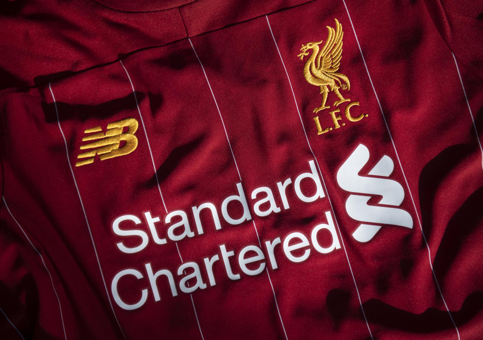 MANCHESTER, ENGLAND - MAY 05: The Liverpool club crest on the first team home shirt displayed with the sponsors Standard Chartered and New Balance on May 5, 2020 in Manchester, England (Photo by Visionhaus)