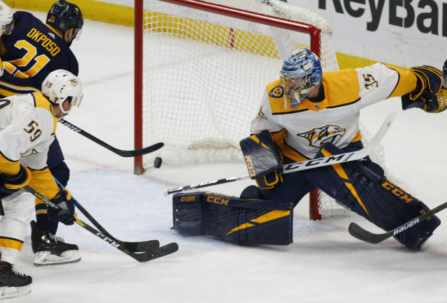 Buffalo Sabres forward Kyle Okposo (21) puts the puck past Nashville Predators goalie Pekka Rinne (35) during the first period of an NHL hockey game Tuesday, April 2, 2019, in Buffalo, N.Y. (AP Photo/Jeffrey T. Barnes)
