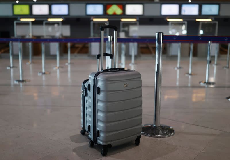 Luggage is seen as a passenger waits for check-in in the departures area of the Terminal 2E at Charles-de-Gaulle airport in Roissy