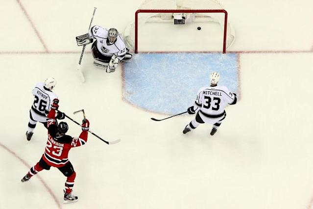NEWARK, NJ - JUNE 09: David Clarkson #23 of the New Jersey Devils celebrates as Bryce Salvador #24 (not pictured) scores in the second period against Jonathan Quick #32 of the Los Angeles Kings during Game Five of the 2012 NHL Stanley Cup Final at the Prudential Center on June 9, 2012 in Newark, New Jersey. (Photo by Jim McIsaac/Getty Images)