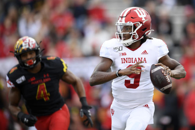 Indiana quarterback Michael Penix Jr. (9) looks to pass as he is pursued by Maryland linebacker Keandre Jones (4) during the first half of an NCAA college football game, Saturday, Oct. 19, 2019, in College Park, Md. (AP Photo/Nick Wass)