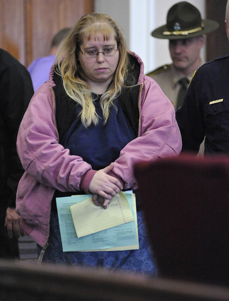 Patricia Prue is led into court Wednesday, March 28, 2012 in St. Johnsbury, Vt. A snow plow driver and his wife are being charged in connection with the killing of a Vermont prep school teacher, who police say was strangled. Thirty-year-old Allen Prue of Waterford and his 33-year-old wife Patricia Prue are facing 2nd degree murder charges in connection with the killing of Melissa Jenkins. (AP Photo/Caledonian-Record, Michael Beniash)