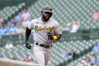 CORRECTS TO TWO-RUN HOME RUN, NOT A THREE-RUN - Pittsburgh Pirates' Anthony Alford rounds the bases after hitting a two-run home run off Chicago Cubs starting pitcher Alec Mills during the sixth inning of a baseball game Friday, Sept. 3, 2021, in Chicago. (AP Photo/Charles Rex Arbogast)