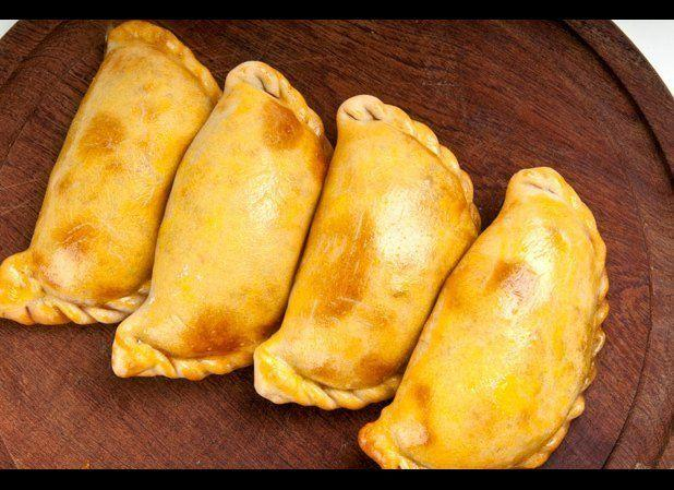 The empanada is the national food of Chile, although it is cooked and served throughout Latin America. They are often filled with beef, fish, or beans and cheese, although there are a variety of preparations. Just outside Santiago, visit Las Hermanas for great Chilean empanadas. <em>Credit: iStockphoto_thinkstock</em>