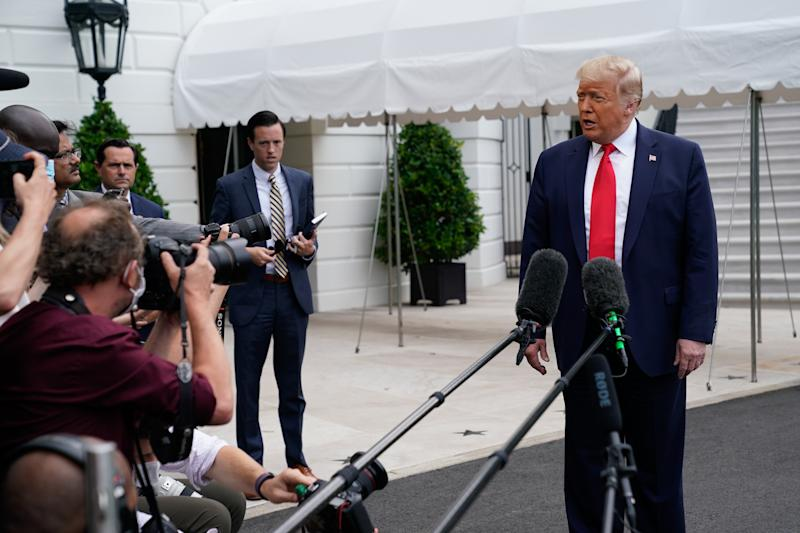 President Donald Trump speaks to reporters before departing the White House in Washington, en route to Florida, on Friday, July 10, 2020. (Erin Scott/The New York Times)