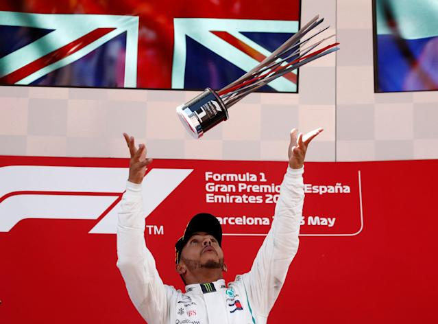 Formula One F1 - Spanish Grand Prix - Circuit de Barcelona-Catalunya, Barcelona, Spain - May 13, 2018 Mercedes' Lewis Hamilton celebrates winning the race with the trophy REUTERS/Juan Medina TPX IMAGES OF THE DAY