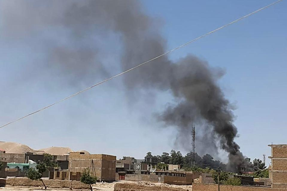 A smoke plume rises from houses amid ongoing fighting between Afghan security forces and Taliban fighters in the western city of Qala-i-Naw, the capital of Badghis province (AFP/Getty)