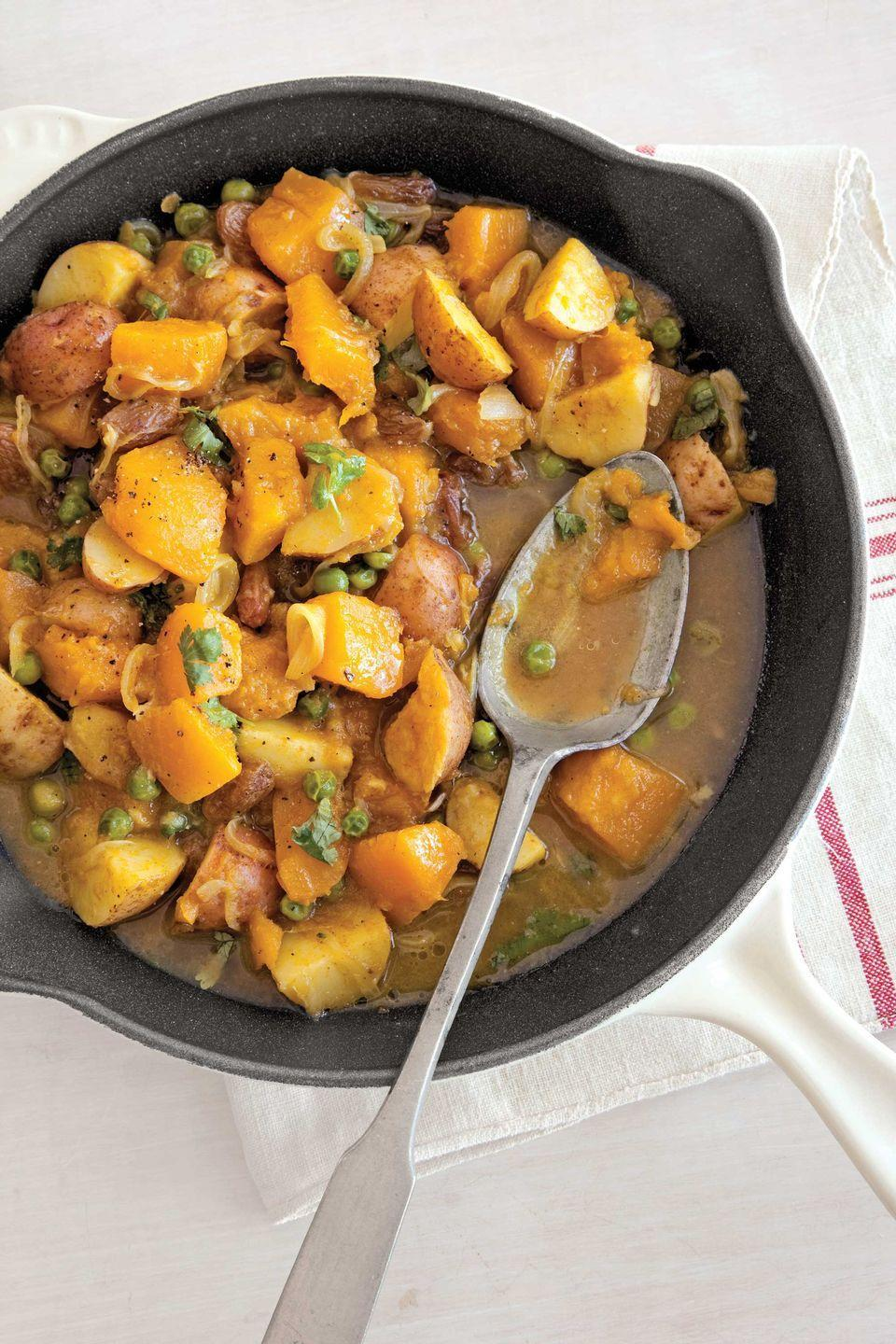 "<p>This spicy side dish featuring tender pumpkin and tomatoes with a touch of curry powder is sure to be a hit. </p><p><strong><a href=""https://www.countryliving.com/food-drinks/recipes/a2994/curried-pumpkin-peas-recipe/"" rel=""nofollow noopener"" target=""_blank"" data-ylk=""slk:Get the recipe"" class=""link rapid-noclick-resp"">Get the recipe</a>.</strong></p>"
