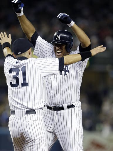 New York Yankees' Ichiro Suzuki (31), of Japan, celebrates with teammate Vernon Wells after a baseball game against the Baltimore Orioles, Friday, July 5, 2013, in New York. The Yankees won the game 3-2. (AP Photo/Frank Franklin II)