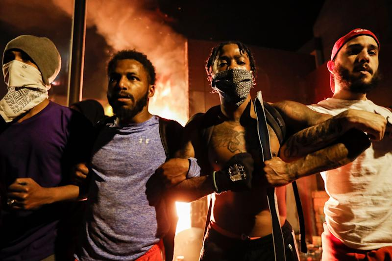 <strong>Protestors demonstrate outside of a burning Minneapolis 3rd Police Precinct, Thursday.</strong> (Photo: ASSOCIATED PRESS)