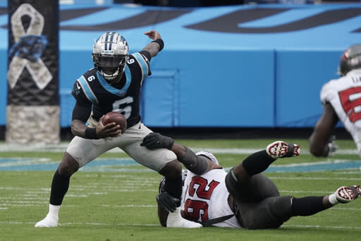 Carolina Panthers quarterback P.J. Walker (6) worlks as Tampa Bay Buccaneers defensive end William Gholston (92) defends during the second half of an NFL football game, Sunday, Nov. 15, 2020, in Charlotte , N.C. (AP Photo/Gerry Broome)