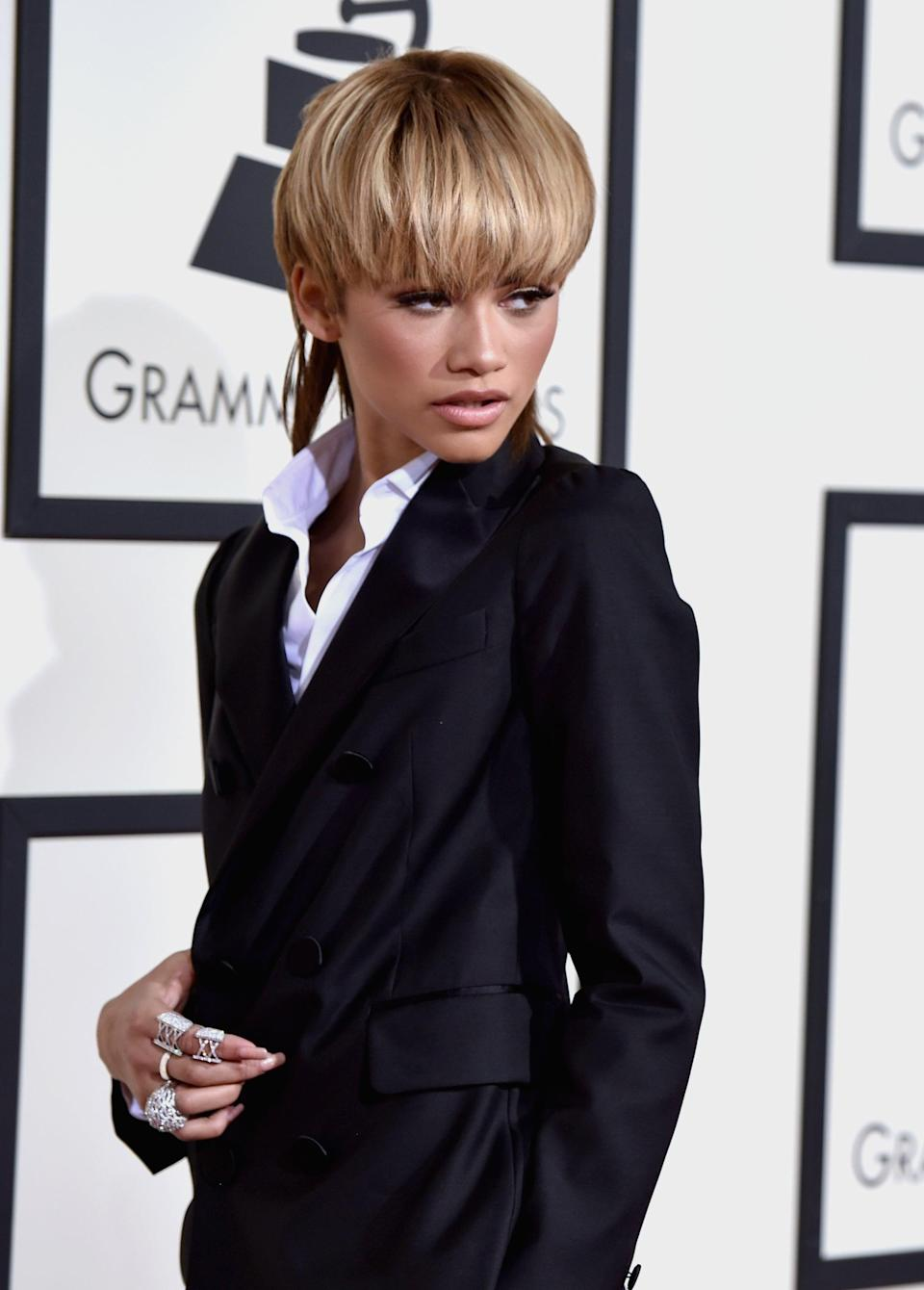 """<p><a class=""""link rapid-noclick-resp"""" href=""""https://www.popsugar.co.uk/Zendaya"""" rel=""""nofollow noopener"""" target=""""_blank"""" data-ylk=""""slk:Zendaya"""">Zendaya</a>'s appearance at the 2016 Grammy Awards was one big tribute to David Bowie, who had died just a month before of liver cancer. Though her headline-making mullet borrowed from Bowie's Ziggy Stardust era, <a class=""""link rapid-noclick-resp"""" href=""""https://www.popsugar.co.uk/Zendaya"""" rel=""""nofollow noopener"""" target=""""_blank"""" data-ylk=""""slk:Zendaya"""">Zendaya</a> told MTV News she was primarily <a href=""""http://www.mtv.com/news/2740489/zendaya-grammys-david-bowie/"""" class=""""link rapid-noclick-resp"""" rel=""""nofollow noopener"""" target=""""_blank"""" data-ylk=""""slk:inspired by his Thin White Duke stage persona"""">inspired by his Thin White Duke stage persona</a> of the mid-1970s. Even her <a href=""""https://www.popsugar.com/fashion/Zendaya-Outfit-2016-Grammys-40199175"""" class=""""link rapid-noclick-resp"""" rel=""""nofollow noopener"""" target=""""_blank"""" data-ylk=""""slk:double-breasted Dsquared2 suit"""">double-breasted Dsquared2 suit</a> closely resembled the tuxedo, shown below, Bowie wore to attend the Grammys in 1975!</p>"""