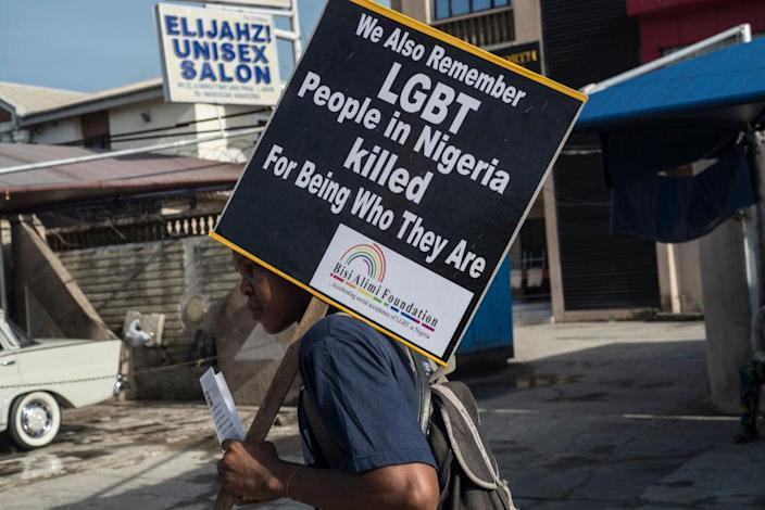 "A young man holds a sign questioning LGBTI killings during a march marking the National Day of Mourning, aiming at commemorating all the lives lost to violent killings and mass displacement in the country, on May 28, 2018 in Lagos.<span class=""copyright"">Stefan Heunis / AFP</span>"