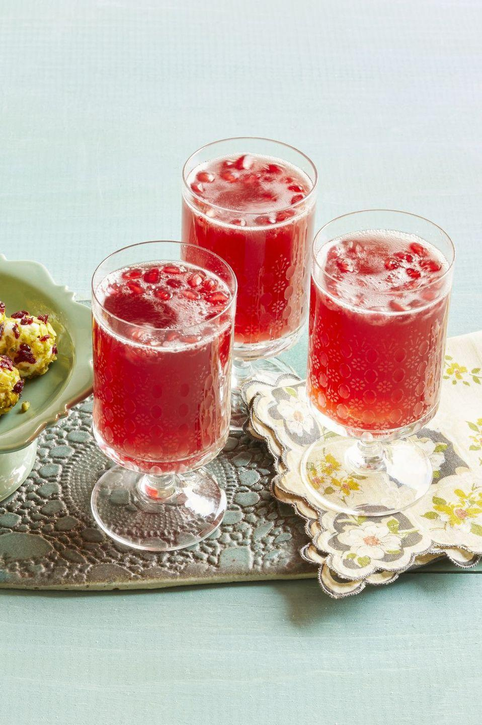 """<p>These pomegranate sparklers shine just as bright as the fireworks. They're light, fruity, and refreshing!</p><p><a href=""""https://www.thepioneerwoman.com/food-cooking/recipes/a32304789/pomegranate-sparklers-recipe/"""" rel=""""nofollow noopener"""" target=""""_blank"""" data-ylk=""""slk:Get Ree's recipe."""" class=""""link rapid-noclick-resp""""><strong>Get Ree's recipe. </strong></a></p><p><a class=""""link rapid-noclick-resp"""" href=""""https://go.redirectingat.com?id=74968X1596630&url=https%3A%2F%2Fwww.walmart.com%2Fsearch%2F%3Fquery%3Dcocktail%2Bglasses&sref=https%3A%2F%2Fwww.thepioneerwoman.com%2Ffood-cooking%2Fmeals-menus%2Fg36432840%2Ffourth-of-july-drinks%2F"""" rel=""""nofollow noopener"""" target=""""_blank"""" data-ylk=""""slk:SHOP COCKTAIL GLASSES"""">SHOP COCKTAIL GLASSES</a></p>"""