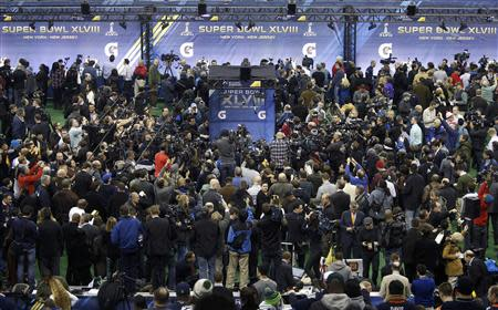 Seattle Seahawks cornerback Richard Sherman is surrounded by cameras and reporters during Media Day for Super Bowl XLVIII at the Prudential Center in Newark, New Jersey January 28, 2014. REUTERS/Carlo Allegri