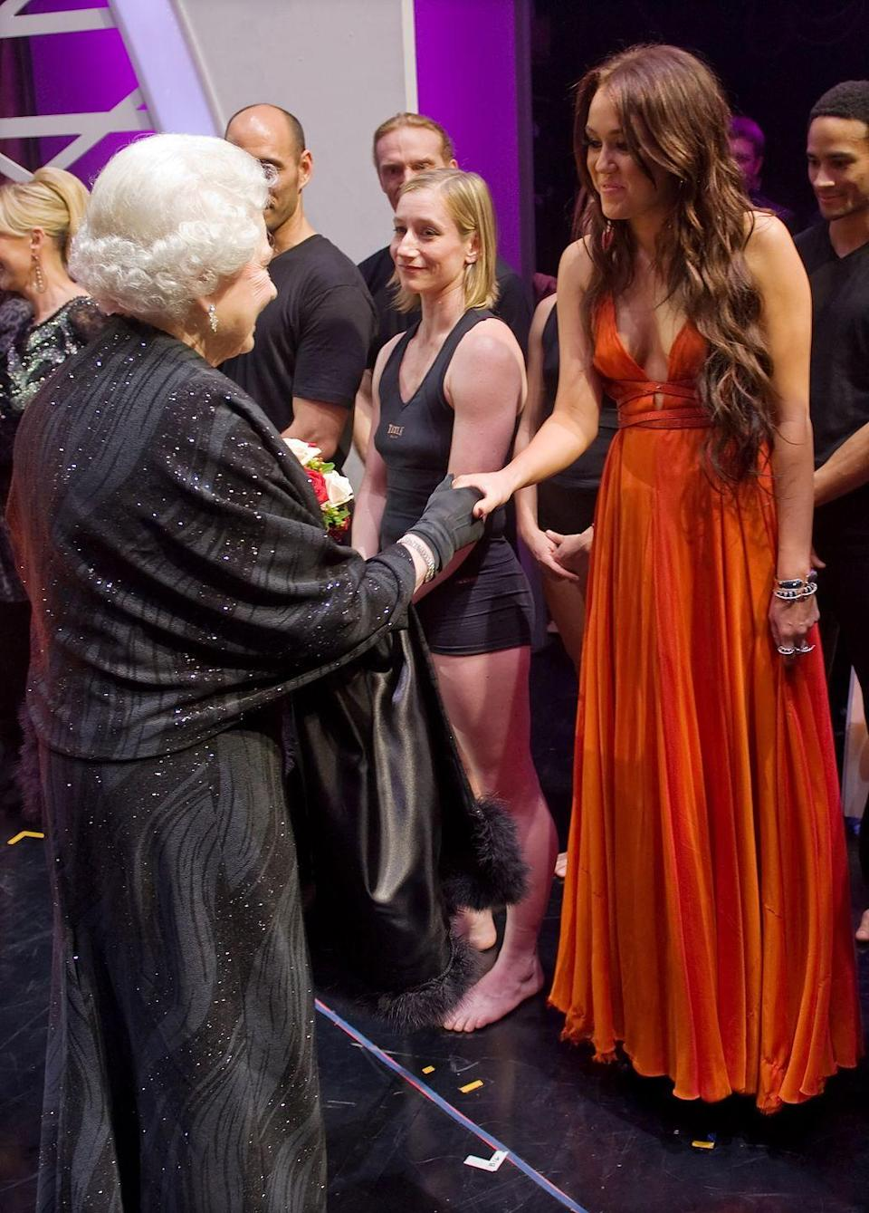 <p>We're not sure what Queen Elizabeth would think of Miley's fashion choices today, but back in 2009, she seemed to approve of the star's burnt orange gown.</p>