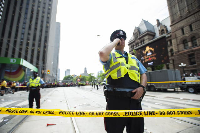 Toronto Police secure the scene after a shots were fired during the Toronto Raptors NBA basketball championship parade in Toronto, Monday, June 17, 2019. (Andrew Lahodynskyj/The Canadian Press via AP)