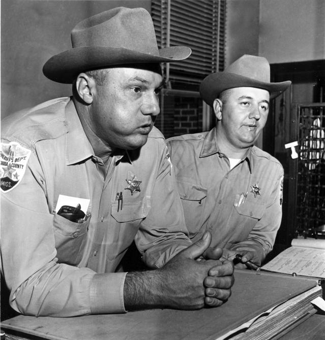 <p>Neshoba County Sheriff Lawrence Rainey, left, and his deputy Cecil Price, are back on the job in Philadelphia, Miss., after being released on a $5,000 bond, Dec. 5, 1964. Rainey and Price were charged by the government in connection with the slaying of three civil rights Freedom Summer workers last June. (Photo: Jack Thornell/AP) </p>