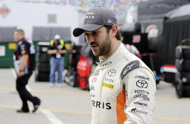 "<a class=""link rapid-noclick-resp"" href=""/nascar/sprint/drivers/3574/"" data-ylk=""slk:Daniel Suarez"">Daniel Suarez</a> walks from the garage after practice for the NASCAR Daytona 500 auto race at Daytona International Speedway in Daytona Beach, Fla., Friday, Feb. 16, 2018. (AP Photo/Terry Renna)"