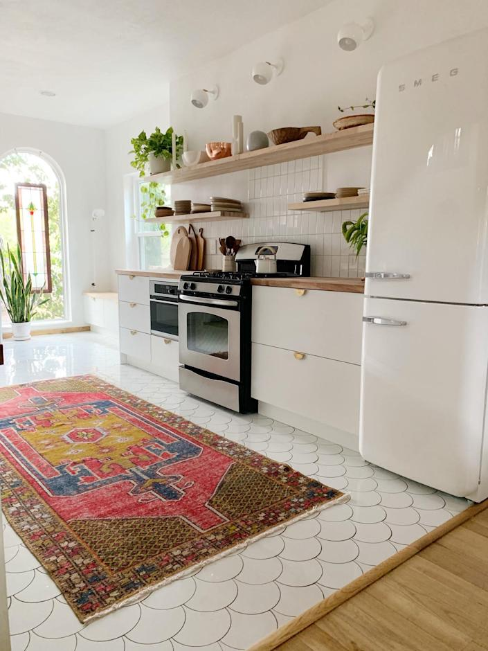 """<div class=""""caption""""> A good point about splurging: Pick something (like the Smeg fridge) that will will be on full display. </div>"""