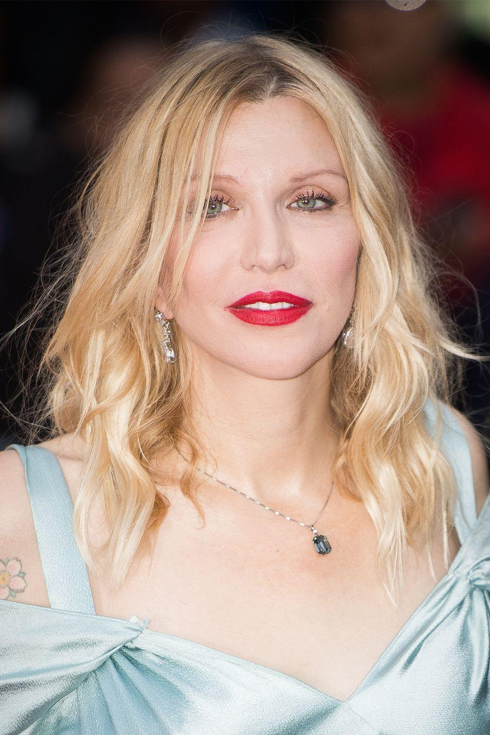 """<p>Love decided to <a href=""""https://www.youtube.com/watch?v=8Zlijf15YAE"""" rel=""""nofollow noopener"""" target=""""_blank"""" data-ylk=""""slk:interrupt Madonna's MTV VMA's interview"""" class=""""link rapid-noclick-resp"""">interrupt Madonna's MTV VMA's interview</a> by throwing her makeup compact at her. Interviewer Kurt Loder invites Love on stage, even though Madonna says, """"No, don't."""" It all goes downhill from there—like when Love says Madonna is mean to her or that she wants to quit music and be a candy striper.</p>"""