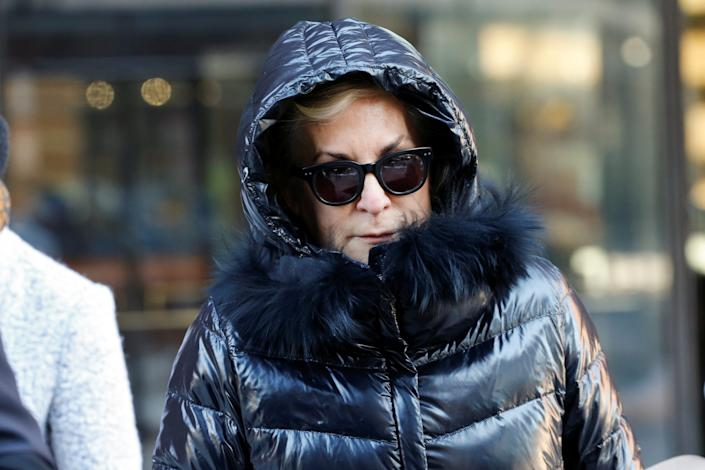 Karen Littlefair leaves the federal courthouse after entering a plea in connection with a nationwide college admissions cheating scheme in Boston on January 22, 2020..JPG
