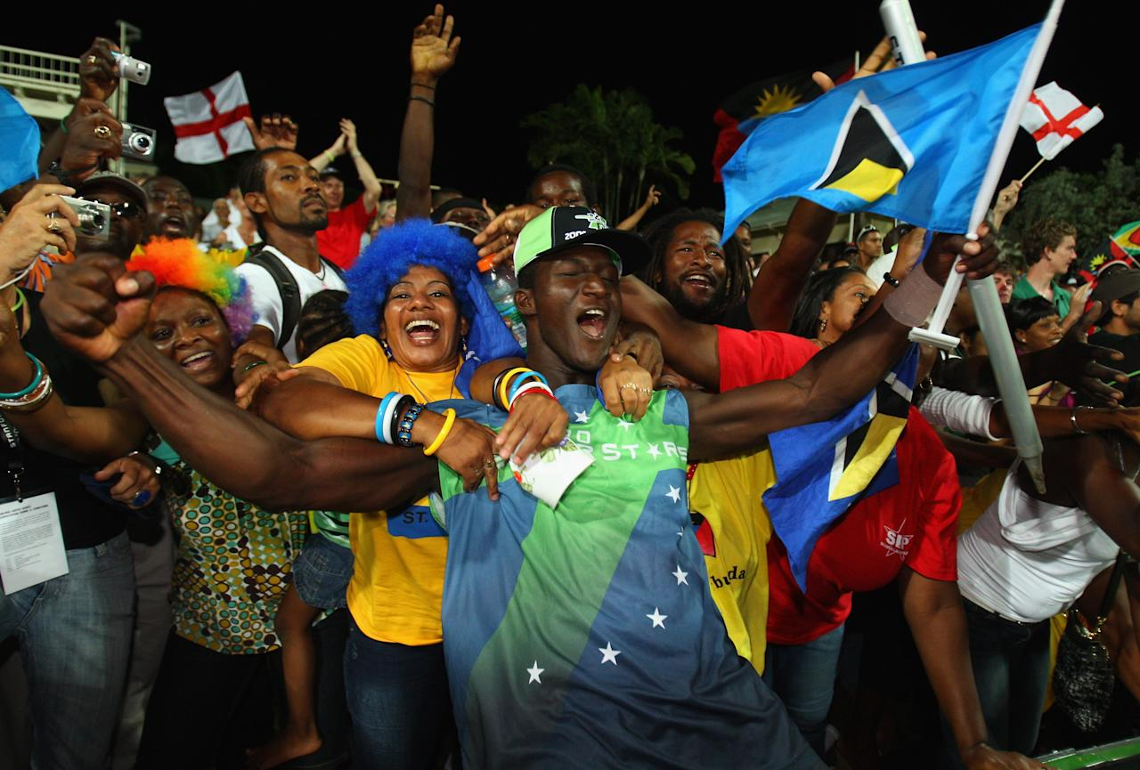 ST. JOHN'S, ANTIGUA AND BARBUDA - NOVEMBER 01:  Darren Sammy of the Superstars is mobbed by  the crowd during the Stanford Twenty20 Super Series 20/20 for 20 match between Stamford Superstars and England at the Stanford Cricket Ground on November 1, 2008 in St Johns, Antigua. (Photo by Tom Shaw/Getty Images)