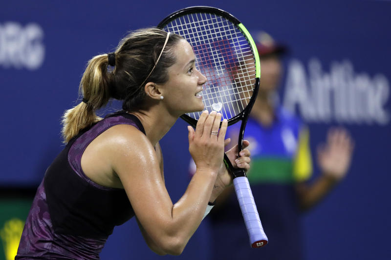 Lauren Davis reacts after her shot was called out against Ashleigh Barty, of Australia, during the second round of the U.S. Open tennis tournament Wednesday, Aug. 28, 2019, in New York. (AP Photo/Adam Hunger)