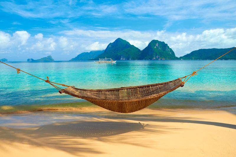 Hammock on the beach next to the ocean