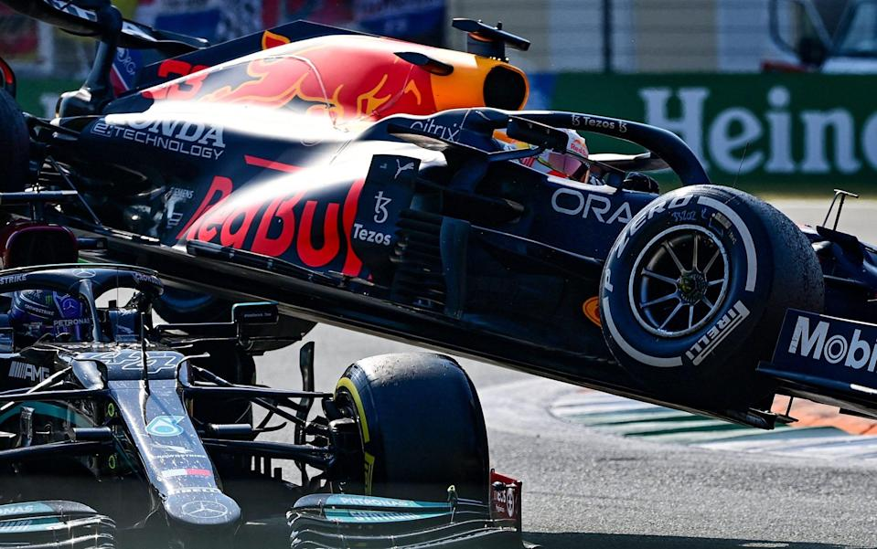 Red Bull's Dutch driver Max Verstappen (R) and Mercedes' British driver Lewis Hamilton collide during the Italian Formula One Grand Prix at the Autodromo Nazionale circuit in Monza, on September 12, 2021. - AFP