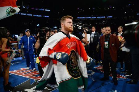 FILE PHOTO: Sep 16, 2017; Las Vegas, NV, USA; Canelo Alvarez enters the ring to face Gennady Golovkin (not pictured) for the world middleweight boxing championship at T-Mobile Arena. The bout ended in a draw. Mandatory Credit: Joe Camporeale-USA TODAY Sports
