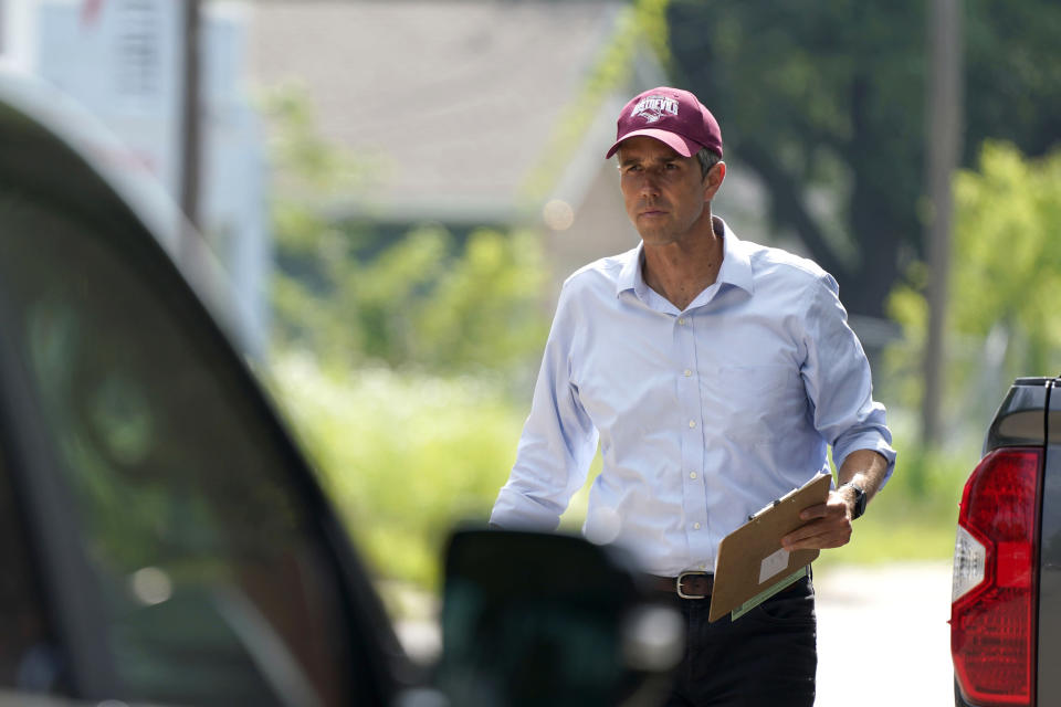 Beto O'Rourke walks a neighborhood in West Dallas Wednesday, June 9, 2021. The former congressman and senatorial candidate is driving an effort to gather voter support to stop Texas' SB7 voting legislation. As politicians from Austin to Washington battle over how to run elections, many voters are disconnected from the fight. While both sides have a passionate base of voters intensely dialed in on the issue, a disengaged middle is baffled at the attention. (AP Photo/LM Otero)