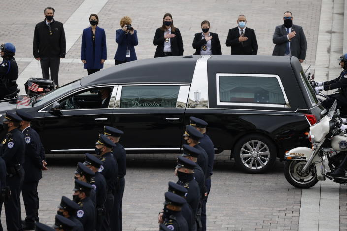 "A hearse carrying the casket of slain U.S. Capitol Police officer William ""Billy"" Evans arrives at the Capitol, Tuesday, April 13, 2021 in Washington. (Carlos Barria/Pool via AP)"