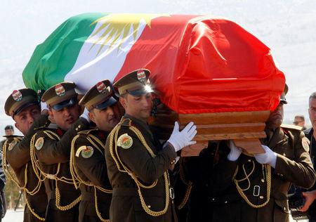 The coffin of former Iraqi president Jalal Talabani is covered with a Kurdish flag at Sulaimaniya Airport, Iraq October 6, 2017. REUTERS/Ako Rasheed
