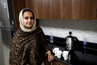 Afghan news anchor Beheshta Arghand poses for photo at a temporary residence compound in Doha
