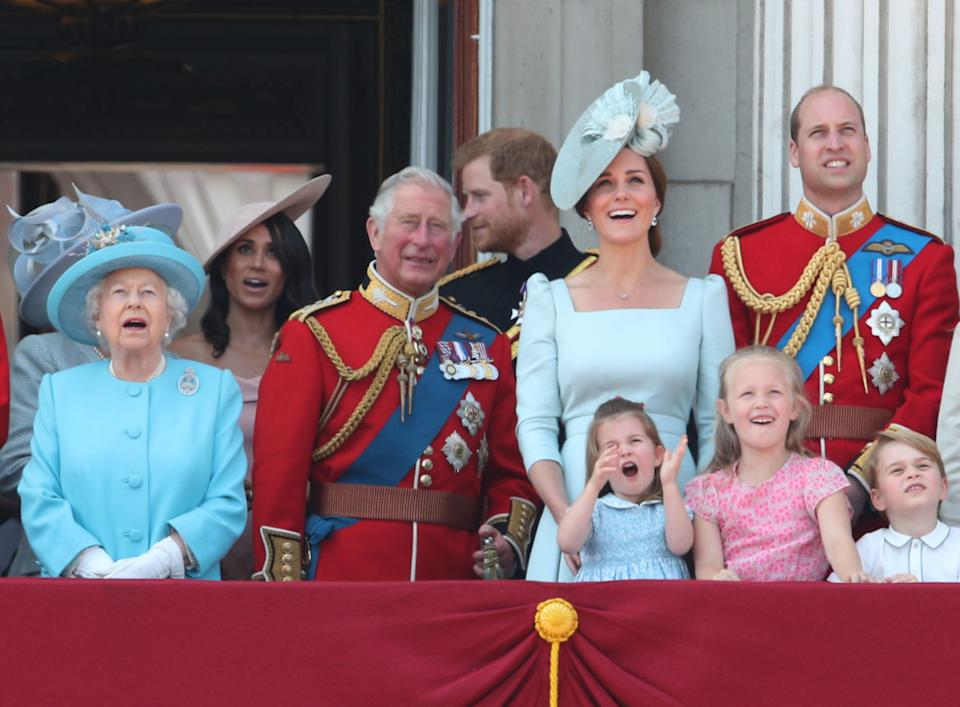 The Queen, Prince of Wales, the Duke and Duchess of Sussex, the Duke and Duchess of Cambridge, Princess Charlotte, Savannah Phillips and Prince George at the 2018 parade. (PA Images)