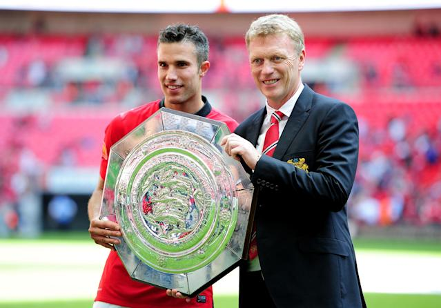 LONDON, ENGLAND - AUGUST 11: Robin van Persie of Manchester United and manager David Moyes pose with the trophy after victory in the FA Community Shield match between Manchester United and Wigan Athletic at Wembley Stadium on August 11, 2013 in London, England. (Photo by Jamie McDonald/Getty Images)