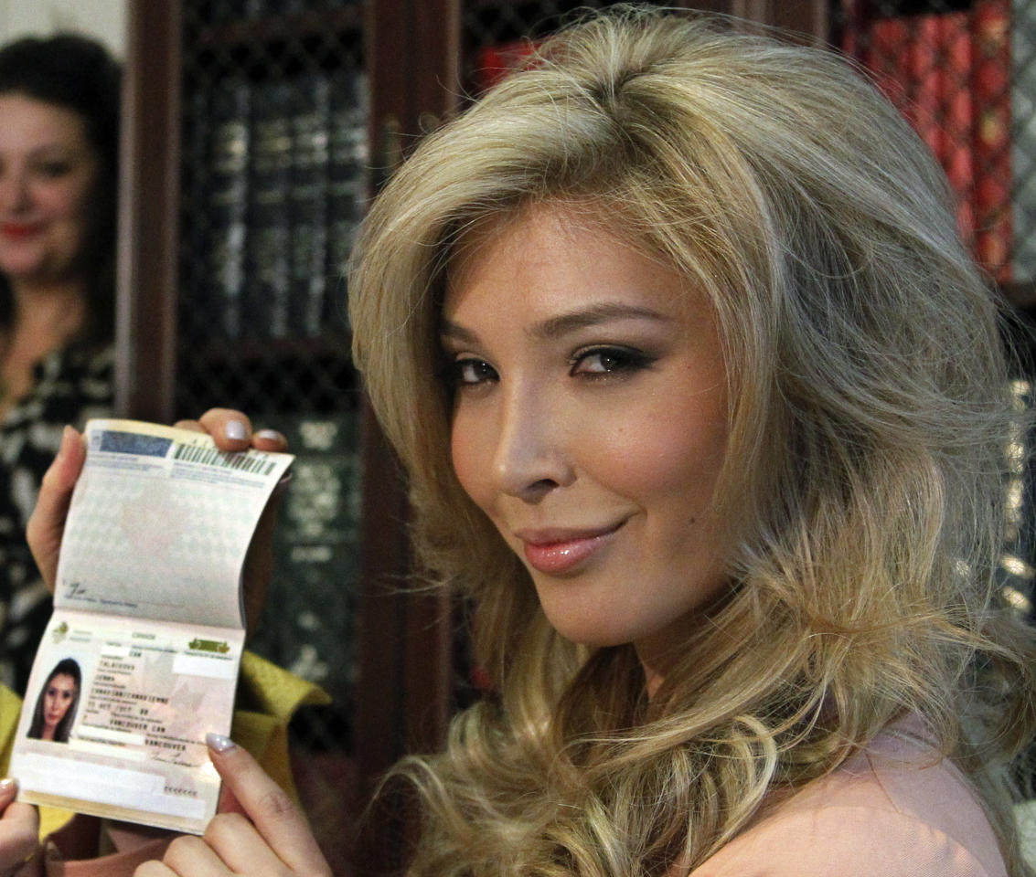 "FILE - In this April 3, 2012, file photo, Jenna Talackova, who advanced to the finals of the Miss Canada competition, part of the Miss Universe contest, shows her passport that lists her gender as female, during a news conference in Los Angeles. Talackova says she was forced out of the competition because Pageant officials alleged she was not ""a naturally-born female."" Transgender women will be allowed to participate in the Miss Universe beauty pageant next year, officials announced Tuesday, April 10, a week after they ruled Talackova could vie for the crown this year. (AP Photo/Reed Saxon, File)"