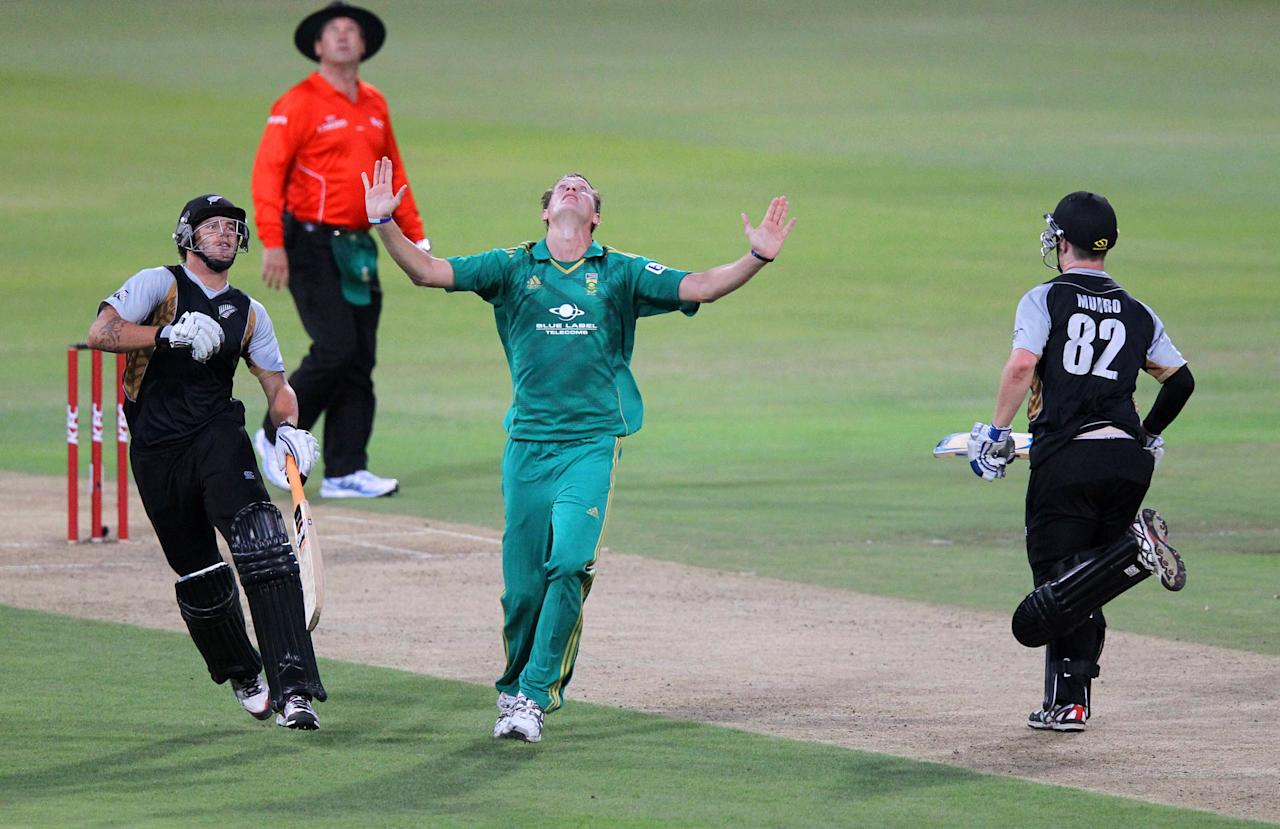 DURBAN, SOUTH AFRICA - DECEMBER 21:   Chris Morris of South Africa (C) calls for a catch during the 1st T20 match between South Africa and New Zealand at Sahara Park Kingsmead on December 21, 2012 in Durban, South Africa. (Photo by Anesh Debiky/Gallo Images/Getty Images)
